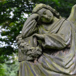 Sad angel statue on old cemetery — Stock Photo #49650449