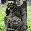 Sad angel statue on old cemetery — Stock Photo #49650455