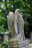 Sad angel statue on old cemetery — Foto Stock