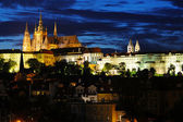Panoramic night view to Lesser Town, Prague castle, St. Nicholas church and Charles bridge — Stock Photo