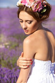 Beautiful Bride in wedding day in lavender field. Newlywed woman in lavender flowers. Young woman in wedding dress outdoors. — 图库照片