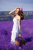 Beautiful Bride in wedding day in lavender field. Newlywed woman in lavender flowers. Young woman in wedding dress outdoors. — Stockfoto