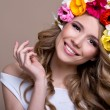 Beautiful woman in a wreath of flowers — Stock Photo #50240947