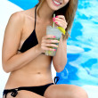 Beautiful woman in bikini near swimming pool — Stock Photo #50979365