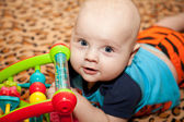 Baby with toy. — Stock Photo
