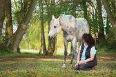 Horse and woman — Stockfoto