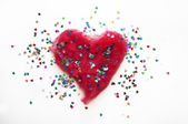 Red heart with glitter on white background — Stok fotoğraf