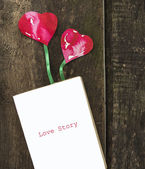 Diary with bookmark two hearts on wooden floor — Stock Photo