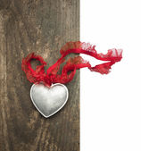Silver heart with lace ribbon on old wood , isolated — ストック写真