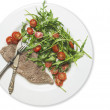 Beef with rocket salad and tomatoes on old wood table, dietetic food — Stock Photo #40181663