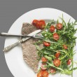 Beef with rocket salad and tomatoes, dietetic food, isolated on gray — Stock Photo #40181781