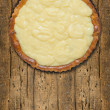 Tart with vanilla custard,preparation for decoration, on old wood — Stock Photo