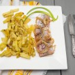 Stock Photo: Fried potatoes with herring and onion in square white plate with old knife and fork on gray wooden table