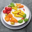Stock Photo: Antipasti vegetables , peppers with cream cheese , hot peppers , olives in plate on gray background
