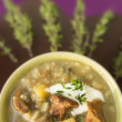 Rice mushroom soup with thyme and chanterelle at lilac Brown background — Stock Photo #41818385
