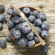 Old basket with blueberries on wooden table, top view — Stock Photo #41852085