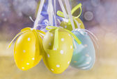 Sunny Easter eggs hanging on ribbons — Stockfoto