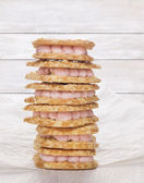 Heap of cookies with pink mousse — Stock Photo