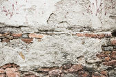 Texture of old brick wall with cracked plaster , background — Stock Photo
