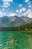 Rescue Helicopter and Beautiful Lake in High Tatra of Slovakia — Stock Photo