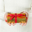 Hand and gift over white background — Stock Photo