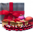 Christmas gifts, with balls. Isolated on white. — Stock Photo #33638729