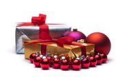 Christmas gifts, with balls. Isolated on white. — Stock Photo