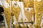 Golden beads and chains in a jewelry shop at Golden Souk in Dubai — Stock Photo