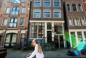 A long-haired cyclist in Amsterdam — Stock Photo