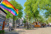 Rainbow flag on the street in Amsterdam — Stok fotoğraf