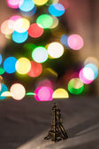 Little Eiffel Tower on the background Holiday lights — Stock Photo