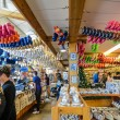 Souvenir shop with a lot of clogs in Amsterdam — Stock Photo