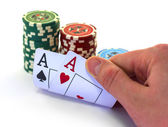 The poker cards with chips isolated in white — Stock Photo