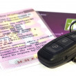 Car key on documents — Stock Photo