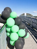 Green and black balloons — Stock Photo