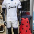 Real Madrid soccer shirt and faralaes dress — Stock Photo