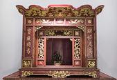 Buddha at a small  altar — Stock Photo
