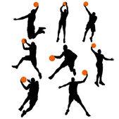Establecer el jugador de baloncesto en acción con la bola — Vector de stock