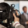 Covering event with video camera — Stock Photo #23533459