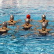 Foto Stock: Synchronized swimmers