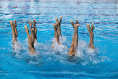 Synchronized swimmers legs movement — Stock Photo