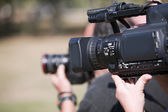 Covering an event with a video camera — Stockfoto
