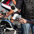 Stock Photo: Interview with bicyclist