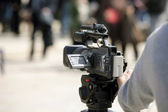 Covering an event with a video camera — Стоковое фото
