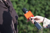 Interview with microphone — Stock Photo