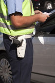 Police officer doing a traffic control — Stock Photo
