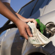 Refueling vehicle at gas station - Stock Photo
