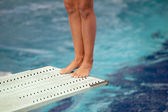 Legs on a springboard — Stock Photo