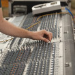 Stock Photo: Hand over music mixer