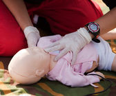 Infant dummy first aid — Stock Photo